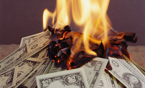 burning-wasting-money